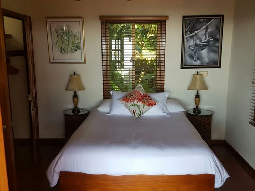 Small double bed in one of the bedrooms at Villas Nicholas in Manuel-Antonio