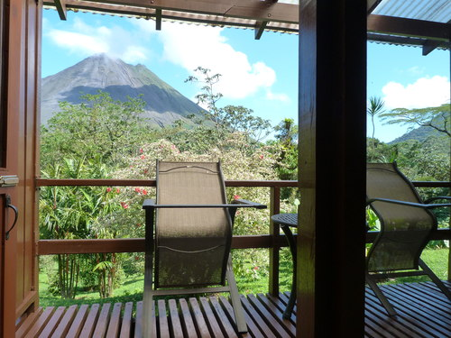 View of La Fortuna Arenal active volcano from observation balcony in Costa Rica