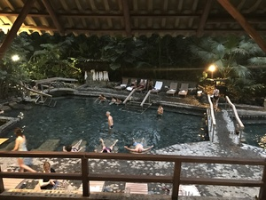 Tourists relaxing in hot springs pool on an excursion in Arenal, Costa Rica