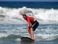 Girl surfing in Costa Rica