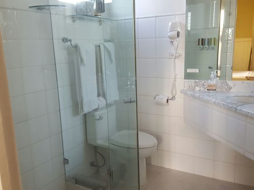 Speical stay bathroom with walk in shower and other necessities in Grand Doro, San Jose