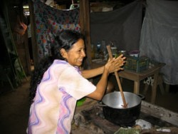 Costa Rican woman cooking food in Bribri Costa Rica