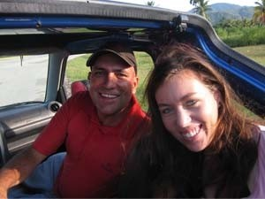 Tourist couple sitting in their Cuban hire car