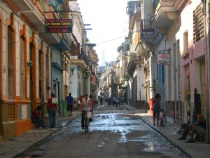local man riding bike in streets of cuba
