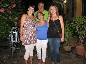rickshaw staff ceri with local family in cuba