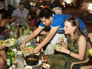 Vietnam customers enjoying local meal