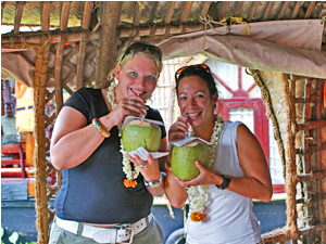 customers drinking coconuts