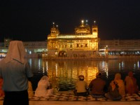 Inida golden temple lit up along river