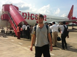 Man standing outside plane in india