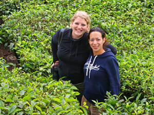 India customers smiling in green tea field