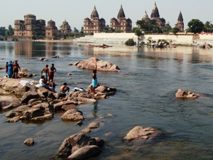 India locals standing along river