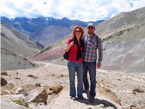 Couple standing with a mountain backdrop in Leh India