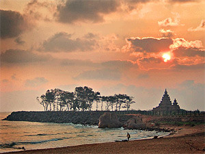 Sun breaking through the clouds on the beach in Tamil Nadu in India