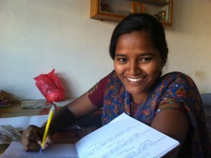 indian woman learning and smiling