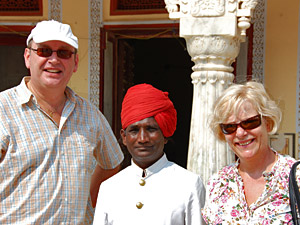 Couple standing with local in India