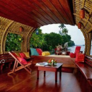 India interior of houseboat with wooden floors and benches