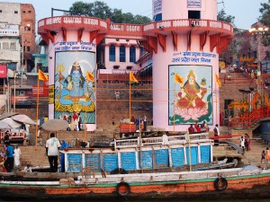 India boats next to colourful murals