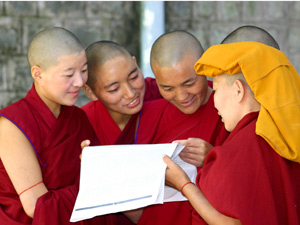 Group of re-robed monks standing together in a huddle