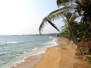 View across sandy deserted beach in Kovalam in India
