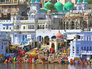 Crowd of people at the river edge in Pushkar India