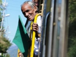 Local man smiling on train in India