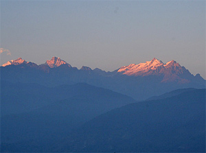 India alpen glow on tops of mountains in India