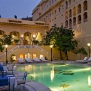 India hotel outdoor pool with lounge chairs