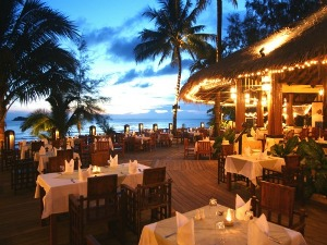 Ko chang outdoor restaurant seating with palm trees
