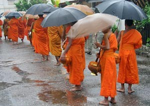 Monks with umbrellas in Laos
