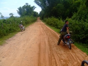 motorbikes on a muddy road
