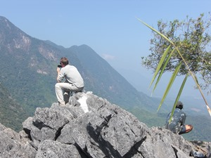 man taking pictures in the mountains