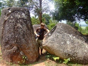 man next to huge rocks