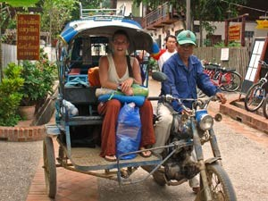 Woman smiling in a tuk tuk in Laos