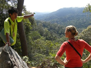 Malaysia customer talking with local in jungle