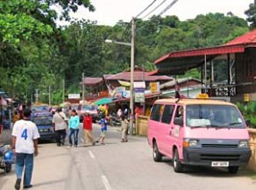 Streets of Pulau Pangkor with characteristic pink taxi