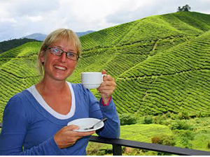 Customer smiling drinking tea green fields