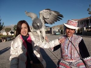 Local Peruvian woman with bird of prey