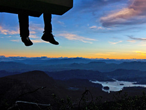 Feet dangling over ledge at Adam's Peak