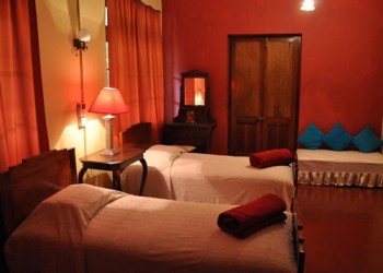 Nice red bedroom of the home stay