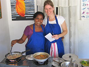 Customer and local woman cooking together