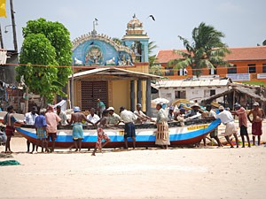 Locals pulling a boat in the town
