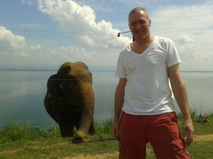 Man in front of elephant in Sri Lanka