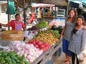 Customers buying fruits on a market in Thailand
