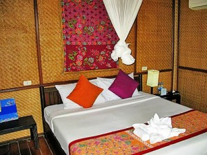 Double bed in the hut of our Standard accommodation