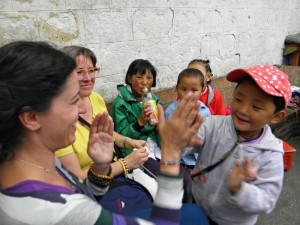 woman playing with children at school for the blind in tibet