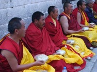 Tibet local monks sitting