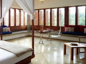 Unawatuna large hotel room with tile floors, bed with netting and windows