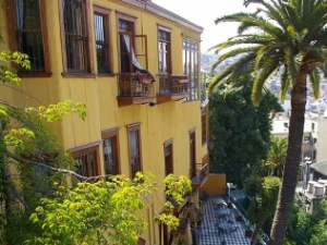Valparaiso hotel from outside with palm trees