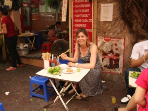 Jeanette trying some local Vietnamese food in Hanoi