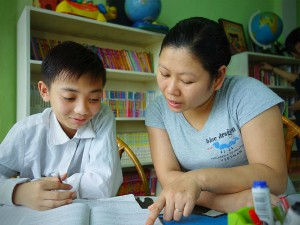 woman teaching boy at blue dragon